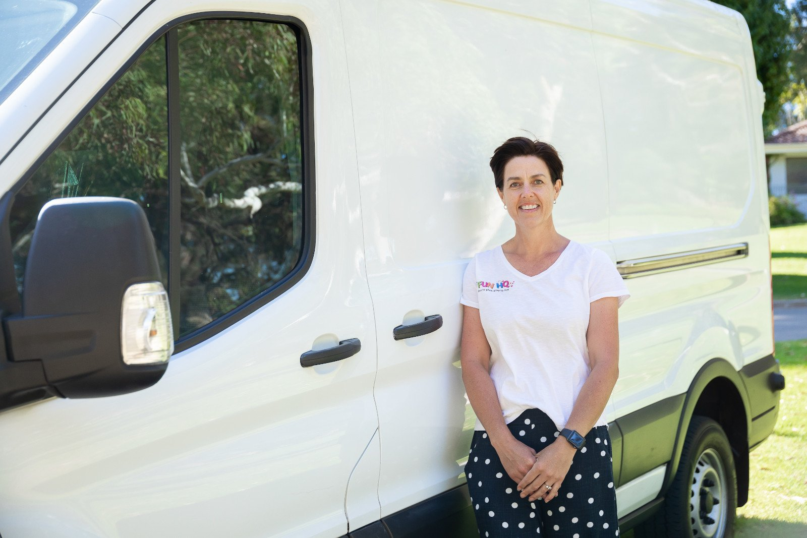 Fun HQ's Emma standing by her delivery van